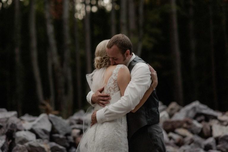 Couple hugging at The Swan Barn Door in Wisconsin Dells